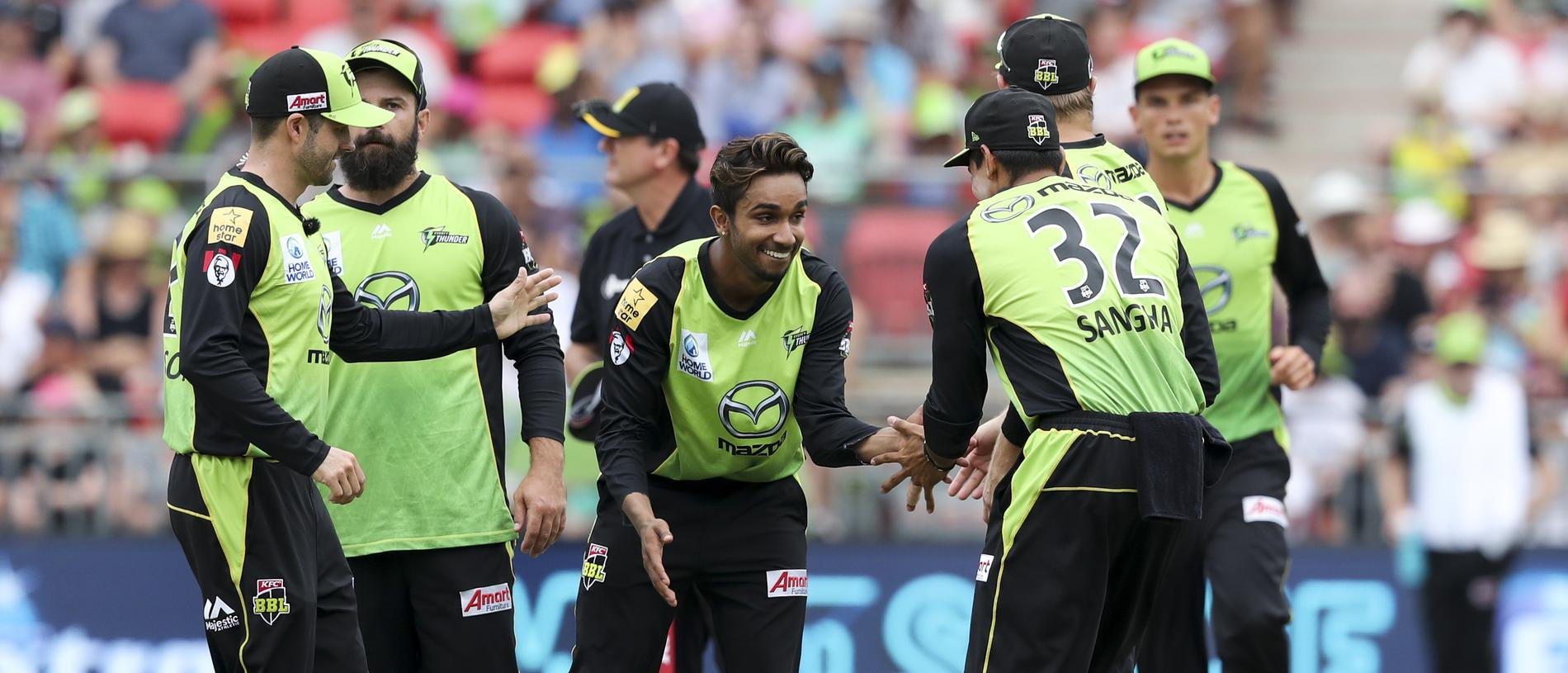 Arjun Nair (centre) of the Thunder celebrates taking the wicket of Ben Laughlin of the Strikers with teammates during the Big Bash League (BBL) match between the Sydney Thunder and the Adelaide Strikers at Spotless Stadium in Sydney, Sunday, January 13, 2019. (AAP Image/David Neilson) NO ARCHIVING, EDITORIAL USE ONLY, IMAGES TO BE USED FOR NEWS REPORTING PURPOSES ONLY, NO COMMERCIAL USE WHATSOEVER, NO USE IN BOOKS WITHOUT PRIOR WRITTEN CONSENT FROM AAP