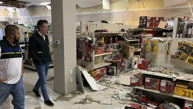 California Governor Gavin Newson, right, tours earthquake damage inside a Sears Hometown Store. Picture: AP