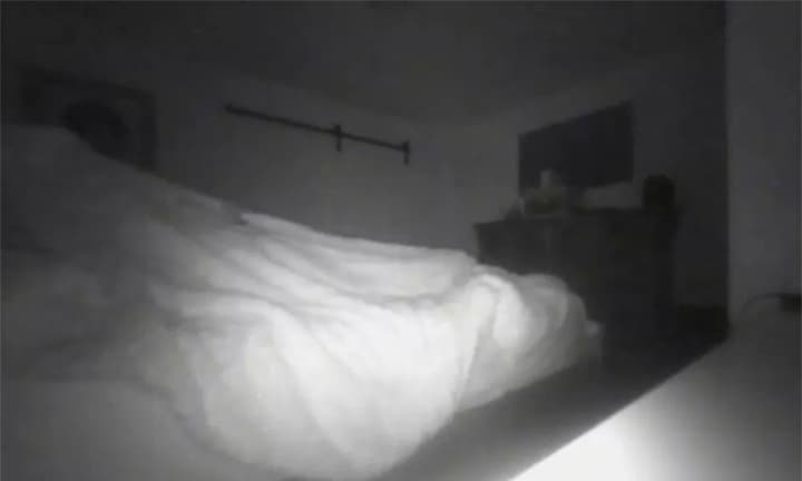 Dad captures images of 'ghost' in his bed