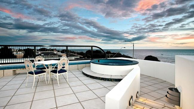 An eight-person rooftop spa on top of the house.