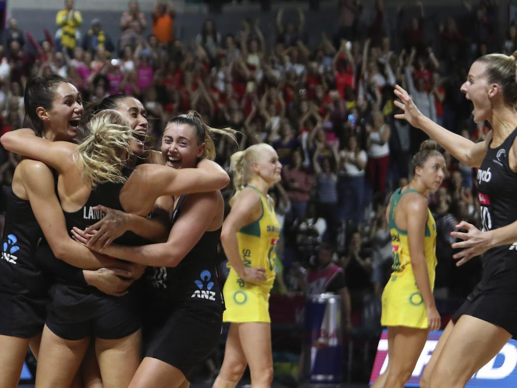 New Zealand's players celebrate after winning the Netball World Cup final match between Australia and New Zealand at M&S Bank Arena in Liverpool, England, Sunday July 21, 2019. (AP Photo/Rui Vieira)