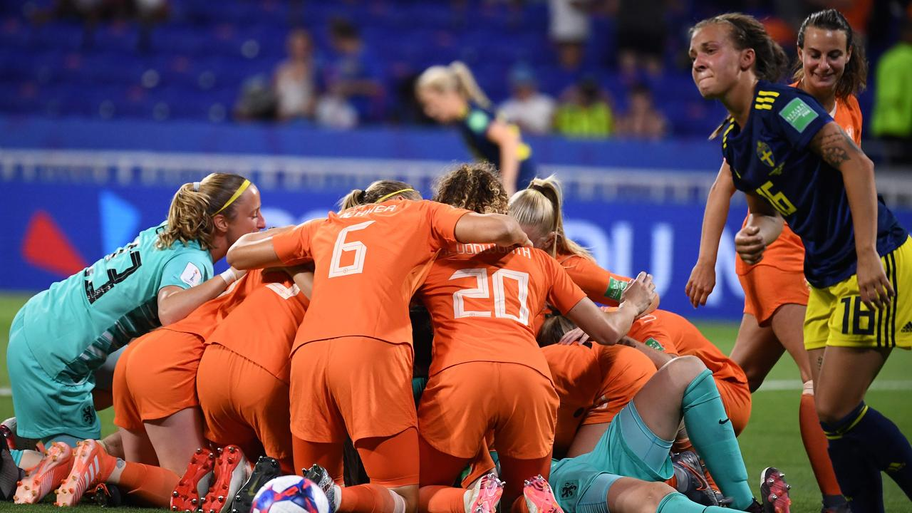 The Netherlands players celebrate beating Sweden