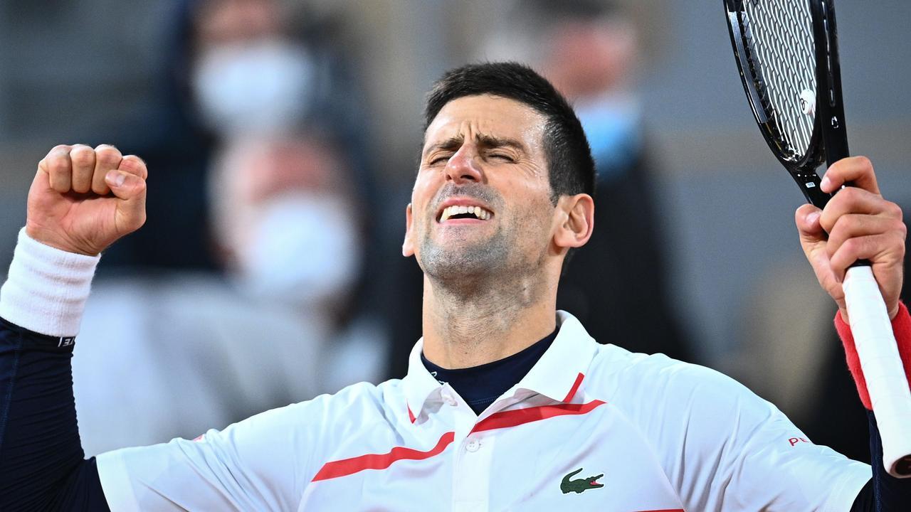 Novak Djokovic celebrates after winning against Spain's Pablo Carreno Busta.