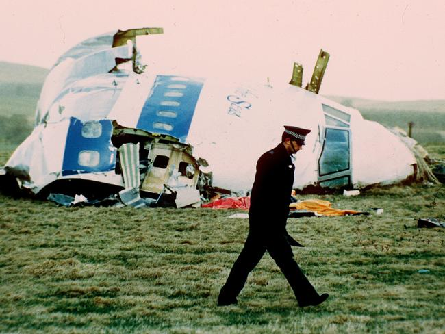 A policeman walks past the nose of the exploded jumbo jet in Lockerbie, Scotland in 1988.