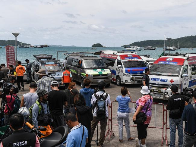Ambulances are seen before recovered bodies of passengers from a capsized tourist boat arrive at Chalong pier in Phuke. Picture: AFP/Mohd Rasfan