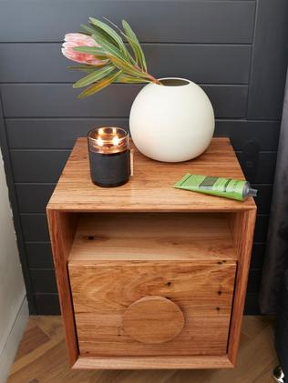 They kept the wooden theme going with this bedside table.
