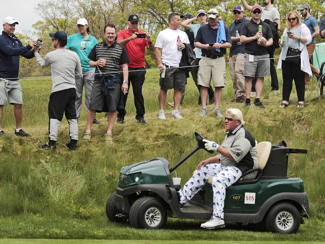 John Daly drives a cart during the second round of the PGA Championship at Bethpage Black in Farmingdale, New York, but has been denied the opportunity at the British Open.