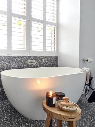 The judges loved the freestanding white bathtub which matched the double sinks. Picture: The Block