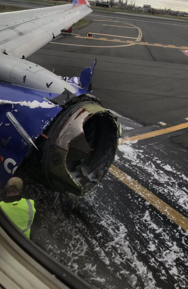 The engine on Southwest Airlines Flight 1380 is seen after the Boeing 737 made an emergency landing at Philadelphia International Airport on April 17, 2018.