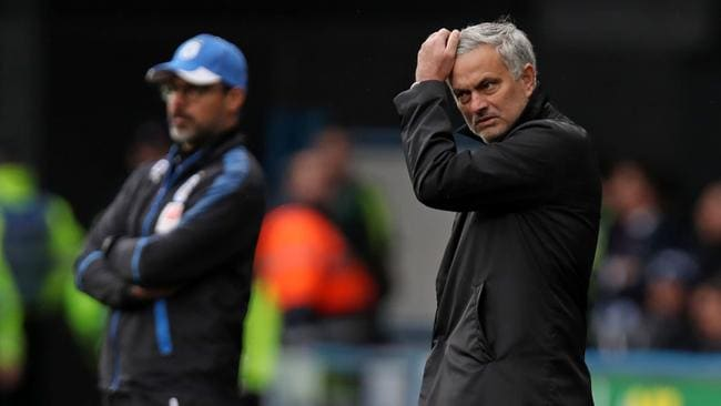 Manchester United's Portuguese manager Jose Mourinho (R) reportedly threw his coat in anger.