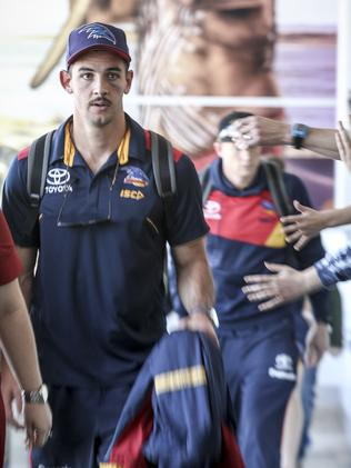 Crows captain Taylor Walker arrives at Adelaide Airport on Sunday afternoon. Picture: Mike Burton/AAP