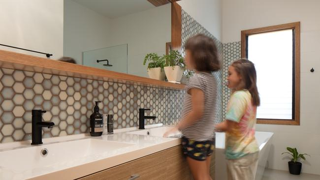 The tiles are a playfully personal touch, referencing a beehive.