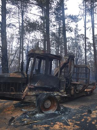 A burnt out tractor in the Wingello State Forest on Monday. Picture: Brett Hemmings/Getty