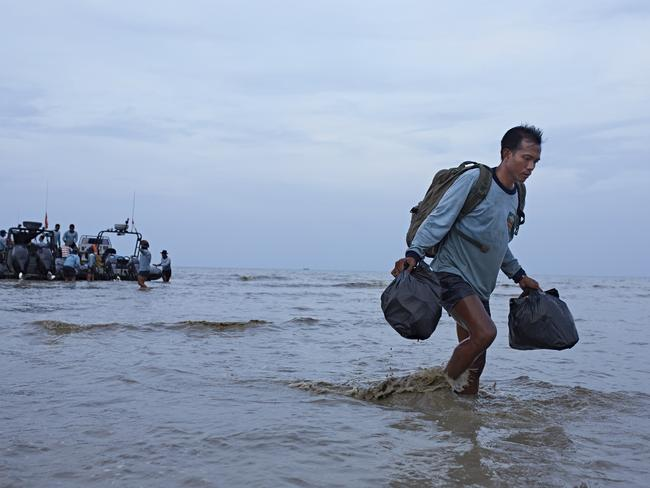 A Navy diver returns to base after a day of searching the wreckage site in Karawang, Indonesia. Picture: Getty
