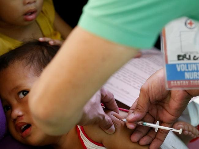 The Philippine health secretary says 136 people, mostly children, have died of measles and 8400 others have been downed by the contagious viral disease. Picture: AP Photo