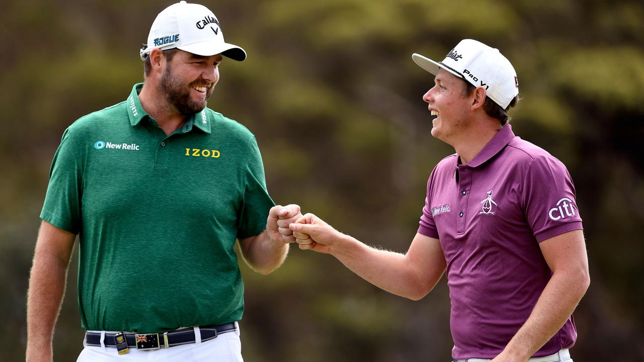 Marc Leishman (left) and Cameron Smith (right) of Australia celebrate a birdie on the final day of the World Cup of Golf. Picture: AFP