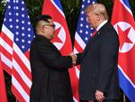 North Korea's leader Kim Jong Un (L) shakes hands with US President Donald Trump (R) at the start of their historic US-North Korea summit, at the Capella Hotel on Sentosa island in Singapore on June 12, 2018.Picture: AFP PHOTO / SAUL LOEB