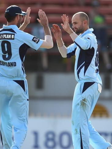 Nathan Lyon of the Blues celebrates a Matador Cup wicket.