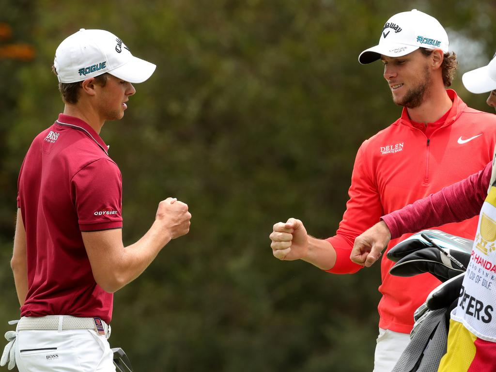 Thomas Pieters and Thomas Detry of Belgium celebrate on the fourth during the World Cup of Golf Tournament at The Metropolitan Golf Club in Melbourne, Sunday, November 25, 2018. (AAP Image/Mark Dadswell) NO ARCHIVING, EDITORIAL USE ONLY