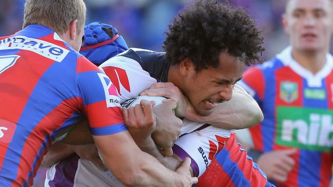 Felise Kaufusi of the Storm is tackled.