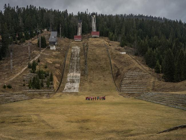 Children gather at the foot of the 1984 Olympic Ski jump hill at Igman just 25km from downtown Sarajevo. The area around the 90m hill was heavily mined during the Bosnian war just 8 years after the 1984 Winter Olympics. (Photo by Giles Clarke/Getty Images)