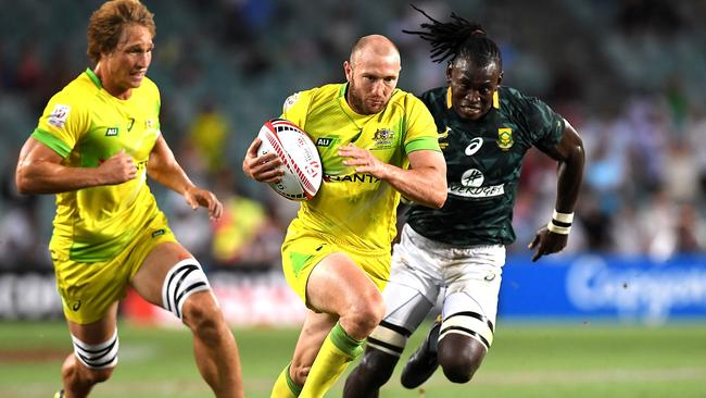 James Stannard of Australia breaks away from the defence in the 2018 Sydney Sevens.