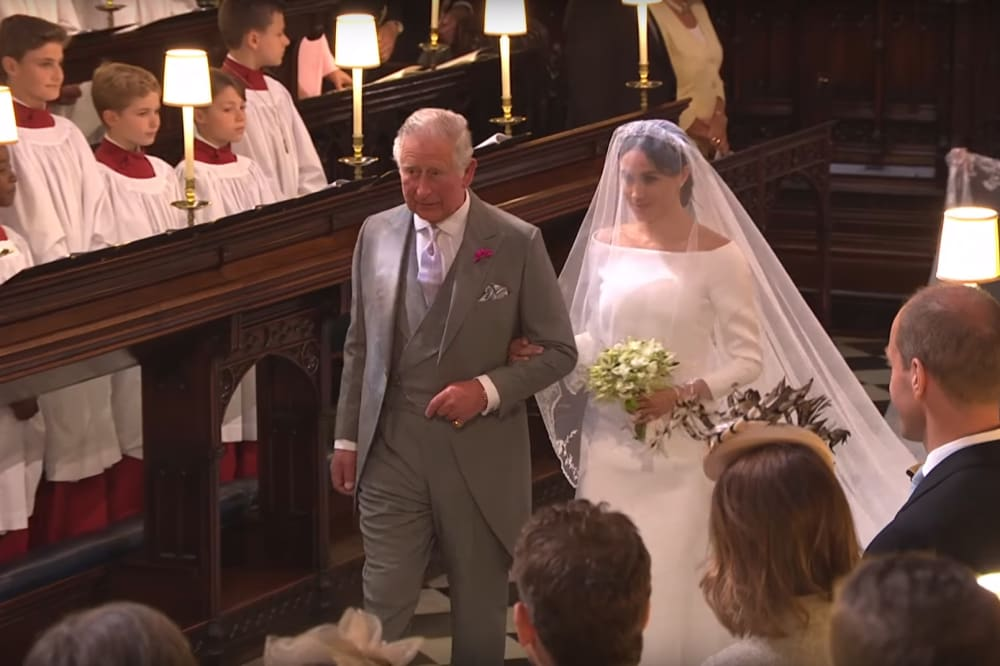 Prince Charles walks Meghan Markle down the aisle at her May wedding. Image credit: BBC