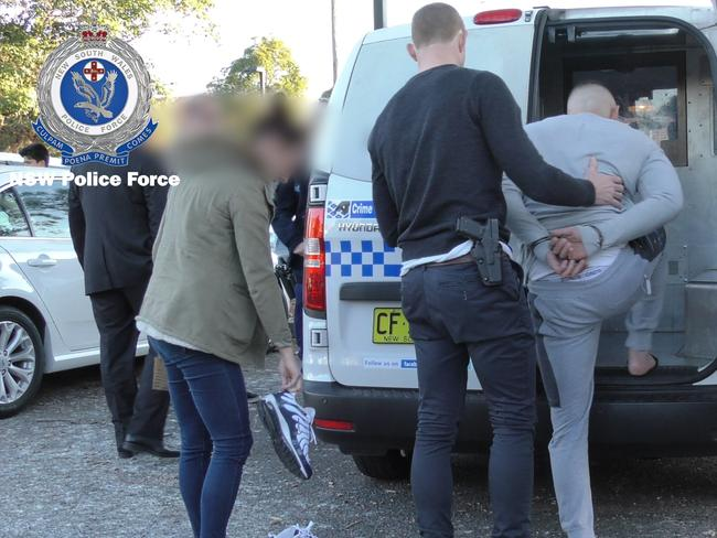 Two members of the Lone Wolf outlaw motorcycle gang (OMCG) and an associate have been charged over their alleged roles in the shooting murder of Mahmoud 'Mick' Hawi.