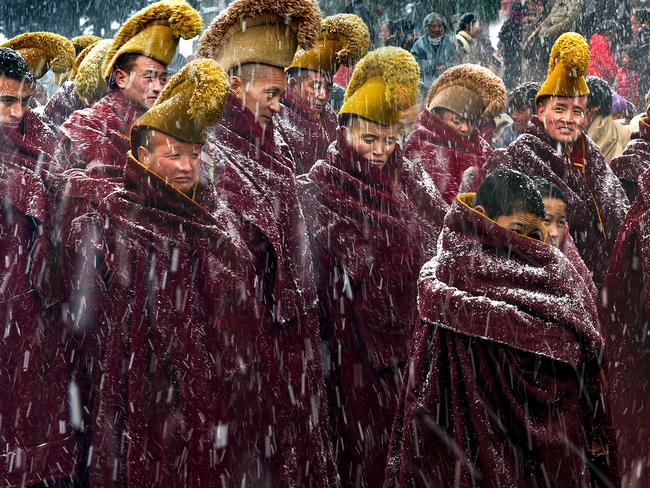 Chinese New Year ... monks at LangMu Temple in heavy snow. Picture: Longxiang Xie, China/2016 Sony World Photography Awards