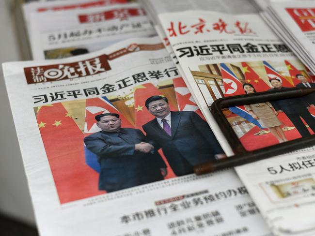 The historic meeting between the two leaders was all over the front pages of Chinese newspapers. Picture: AFP/Fred Dufour