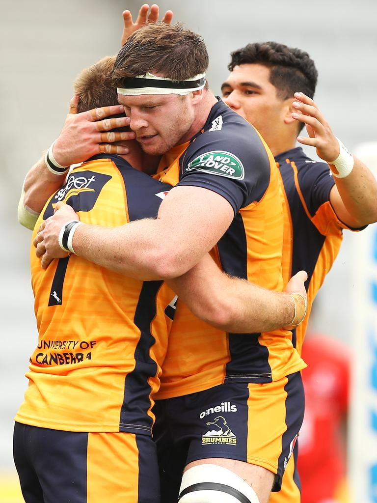 Will Miller of the Brumbies celebrates with Murray Douglas.