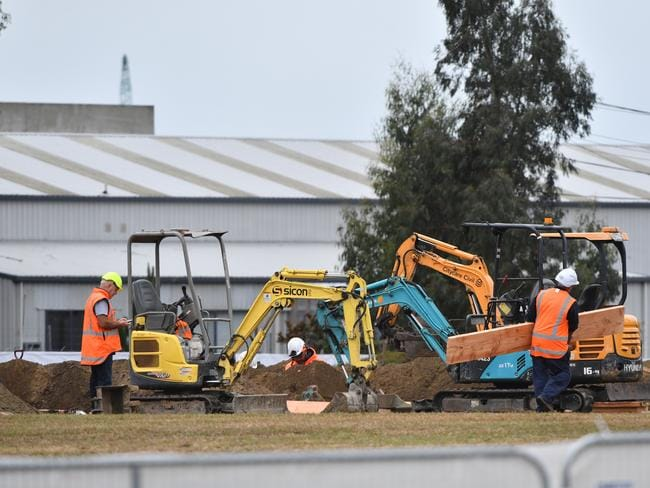 Workmen are seen digging a series of graves at the Memorial Park Cemetery in Christchurch. Picture: AP