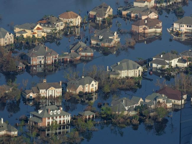 New Orleans houses submerged by oil and water in the aftermath of the storm in September 2005. Picture: AFP