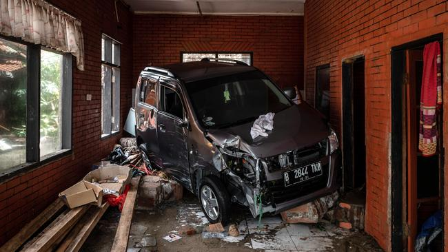 A damaged car is seen inside a destroyed building after being hit by tsunami at a hotel resort. Picture: Getty