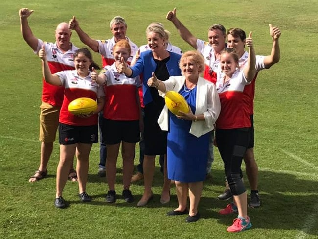Bridget McKenzie with Coalition MP Michelle Landry and a sports team that received $146,200 in Yeppoon in her marginal seat.