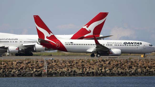 Qantas estimates reduced travel due to coronavirus will slice between $100 million and $150 million from its earnings this year. Picture: AP Photo/Rick Rycroft, File.