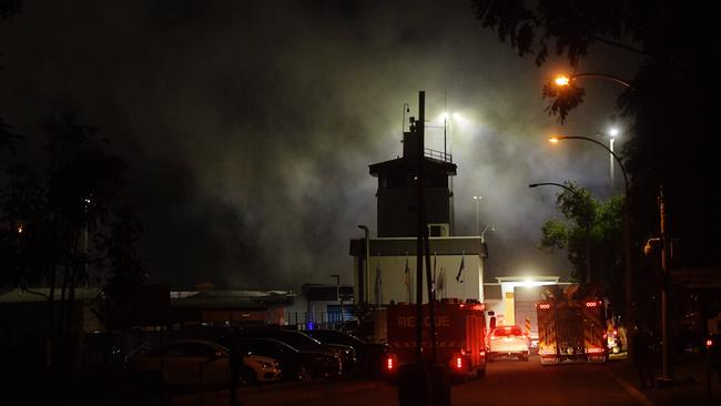 Smoke pours from inside the Don Dale centre after parts of the facility were set alight. Picture: Keri Megelus