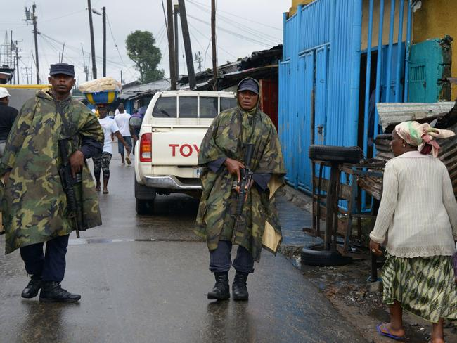 Quarantine ... Liberian soldiers patrol in Monrovia's West Point slum to enforce the quarantine of victims. Source: AFP