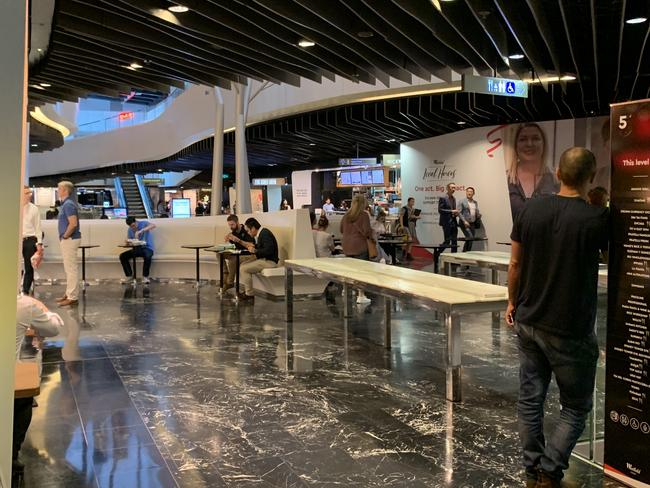 The Westfield Sydney food court still had people sitting inside eating their lunch after the ban came into effect.