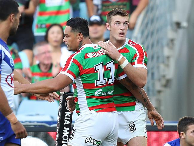 Souths players celebrate the match winning try.