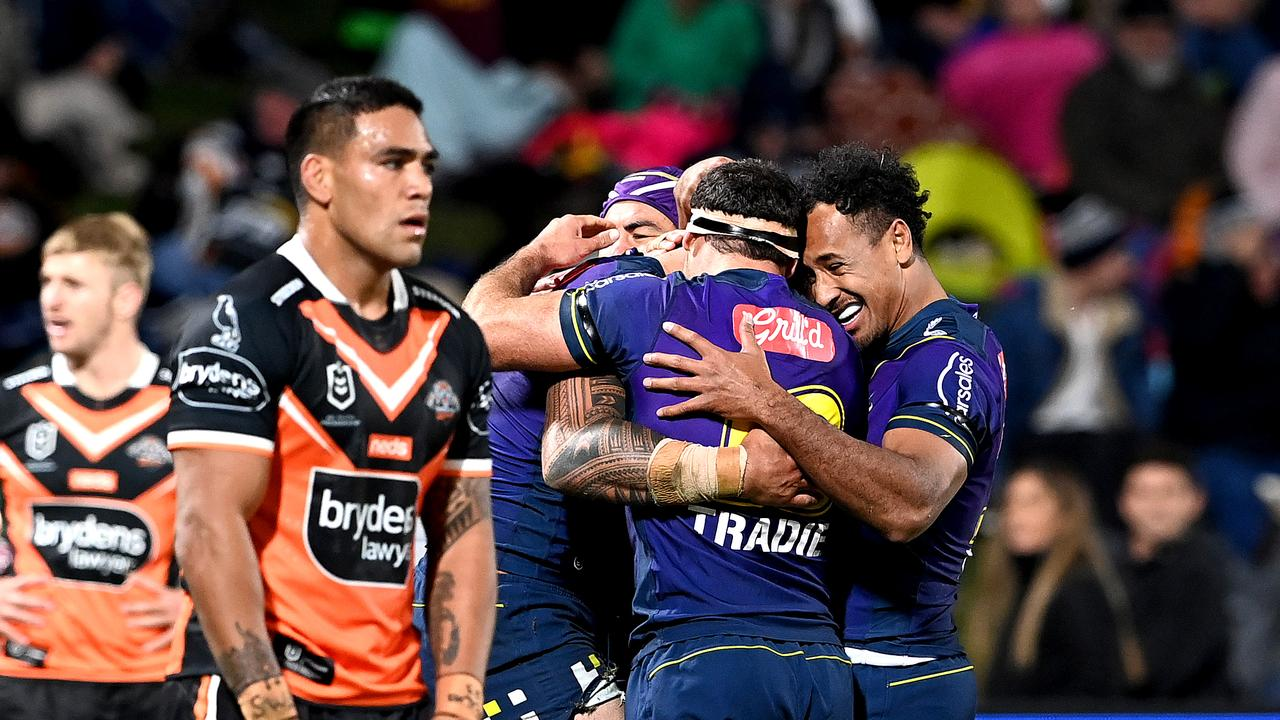 Nelson Asofa-Solomona is congratulated by teammates after scoring a try