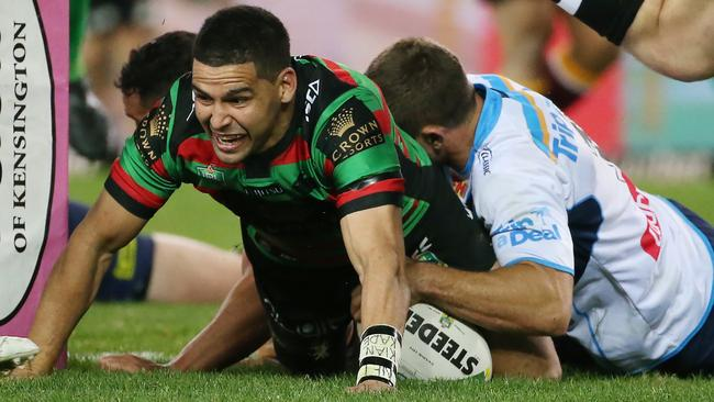 Cody Walker of the Rabbitohs (centre) reacts after scoring a try.