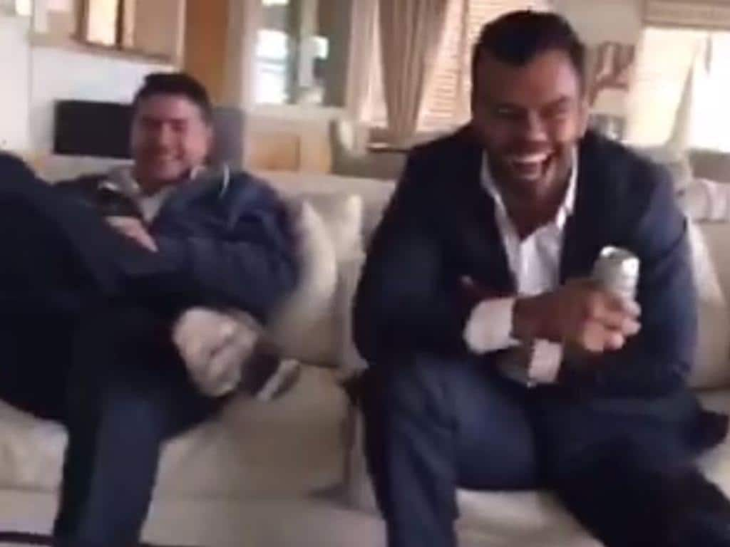 Stu Laundy and Kurtley Beale laugh in the first video to emerge this week.