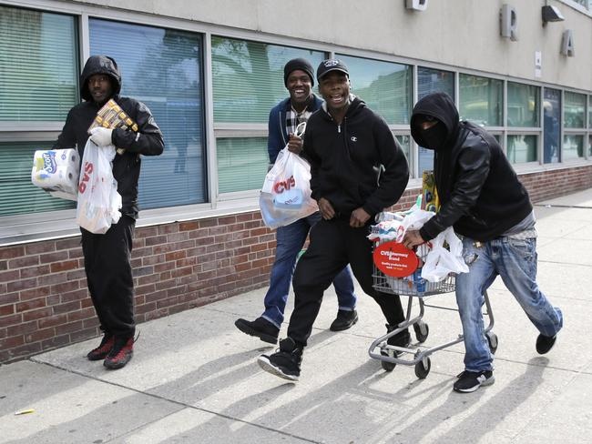 Looting ... Protesters broke into shops and took items. Picture: AP /Patrick Semansky