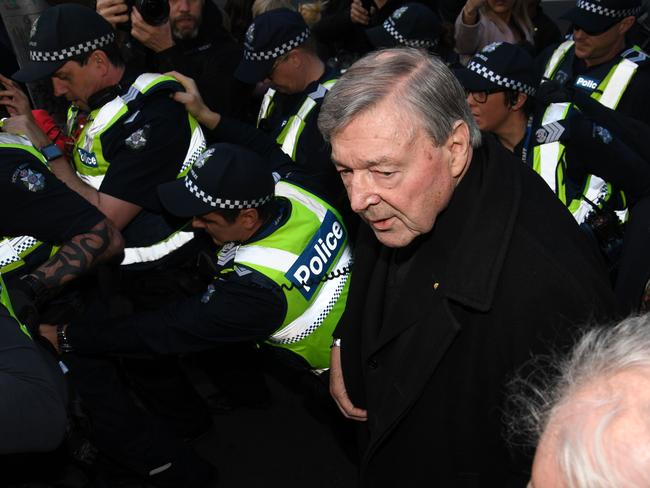 Cardinal George Pell arrives, surrounded by Victorian Police officers at the Melbourne Magistrates Court in Melbourne, Australia, Wednesday, July 26, 2017. Picture: Tracey Nearmy/AAP