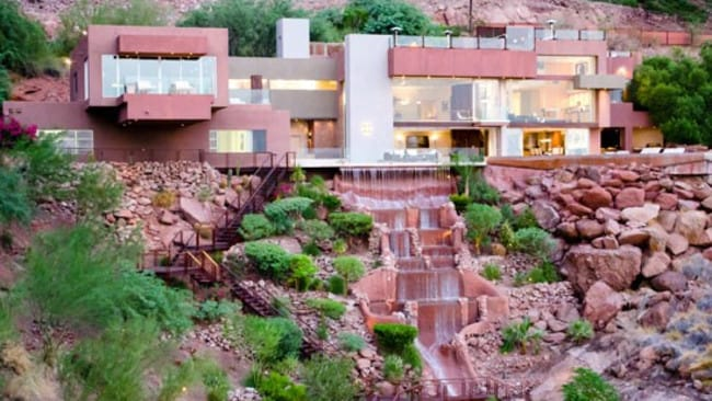 Camelback Mountain, Arizona. Waterfront properties are all the rage these days. This one has a stream running through it then cascading down the mountainside beneath it. Picture: HomeAway.com.au