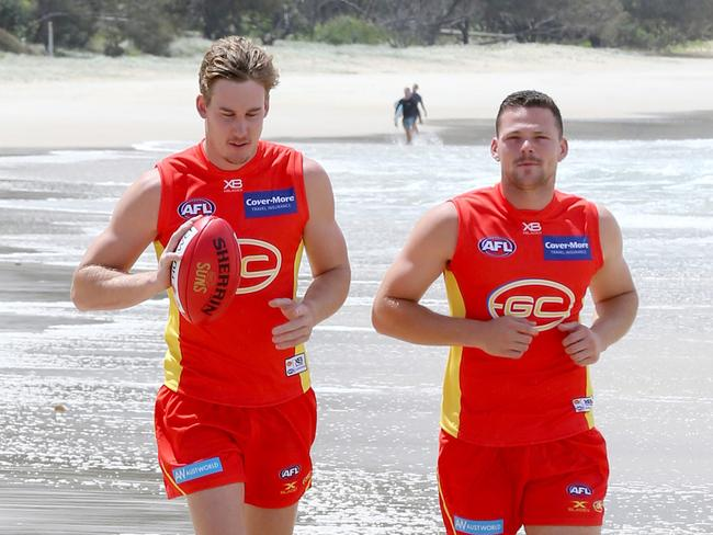 Gold Coast co-captains Tom Lynch and Steven May. Picture: Mike Batterham