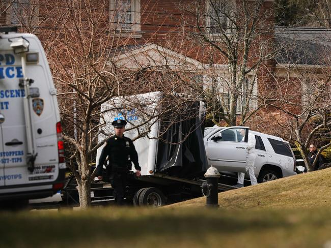 Cali's car is removed by investigators following his shooting death outside his Staten Island home. Picture: AFP