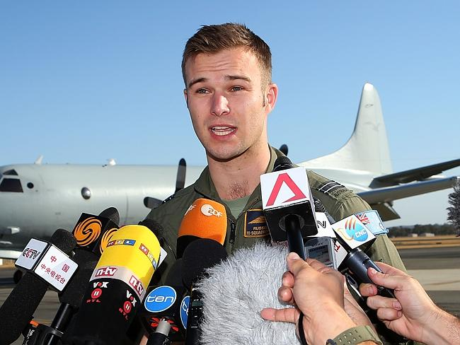 Royal Australian Air Force pilot Capt. Russell Adams addresses media from around the world. Picture: Getty Images