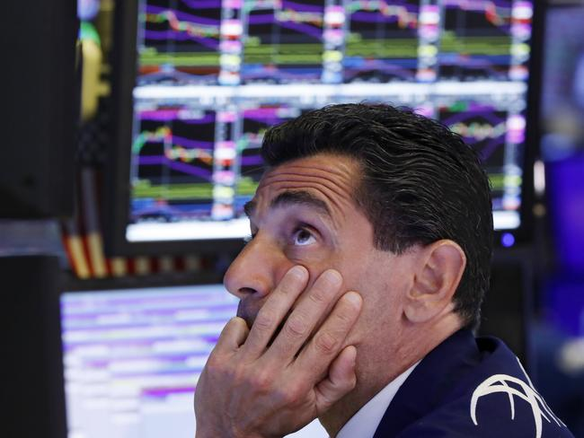 The mood was flat on the floor of the New York Stock Exchange overnight. Investors opened the week heading for safety amid heightened anxiety over the US-China trade war. Picture: AP
